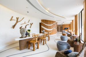 Restoran või mõni muu söögikoht majutusasutuses Bandara Phuket Beach Resort