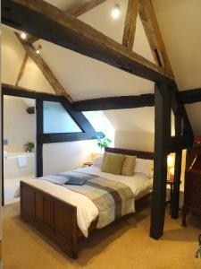 A bed or beds in a room at Garway Moon Inn