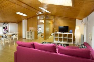 A seating area at Apartment Bambola