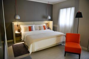 Cama ou camas em um quarto em Clarion Faria Lima