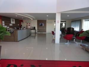 The lobby or reception area at Di Napoli Plaza Hotel