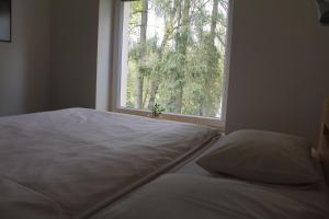 A bed or beds in a room at Apartment Dejvice