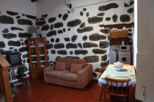 Uma área de estar em casa da Madrinha