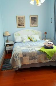 A bed or beds in a room at The Old Post Office Guesthouse B&B
