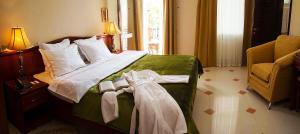 Кровать или кровати в номере Пансионат Родина