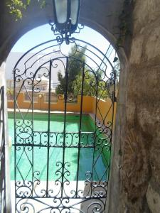 A view of the pool at Posada El Castillo or nearby
