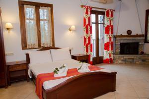 Ένα ή περισσότερα κρεβάτια σε δωμάτιο στο Ξενώνας Έναστρον