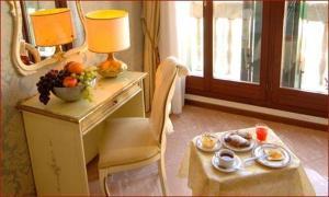 Opções de café da manhã disponíveis para hóspedes em Hotel Canal & Walter