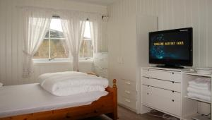 En eller flere senger på et rom på Sandli Overnatting