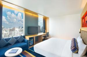 A television and/or entertainment centre at Aloft Bangkok - Sukhumvit 11