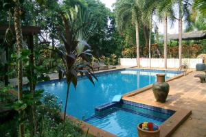 The swimming pool at or close to Coconut Villa