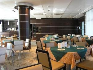 A restaurant or other place to eat at Dado Hotel International