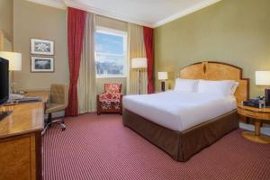 A bed or beds in a room at Hilton London Paddington