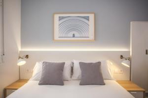 A bed or beds in a room at Malasaña Central Suites