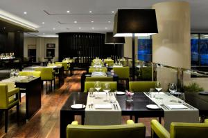 A restaurant or other place to eat at Pullman Dubai Creek City Centre Residences