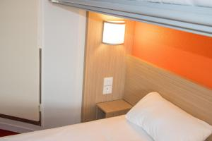 A bed or beds in a room at Premiere Classe Nantes Est St Sebastien Sur Loire