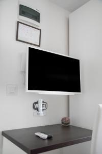 Телевизор и/или развлекательный центр в Sobe Novi grad