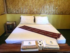 Cama o camas de una habitación en Garden Bay Beach Resort El Nido