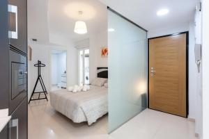Cama o camas de una habitación en My Loft 4 You Na Jordana