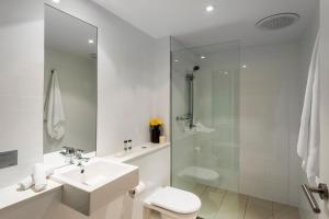 A bathroom at Oaks Nelson Bay Lure Suites