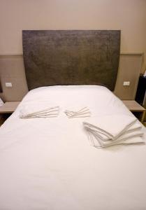Letto o letti in una camera di Marbia Guest House