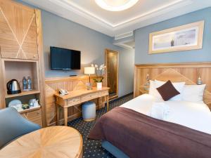 Säng eller sängar i ett rum på Hotel Haffner