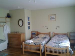 A bed or beds in a room at The Stone House B&B