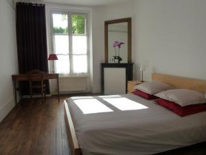 Un ou plusieurs lits dans un hébergement de l'établissement Les Carrés
