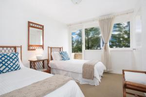 A bed or beds in a room at A PERFECT STAY - King Tide