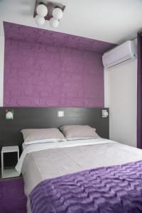 Кровать или кровати в номере Sobe Novi grad