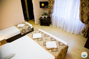 A bed or beds in a room at Hotel Corfu