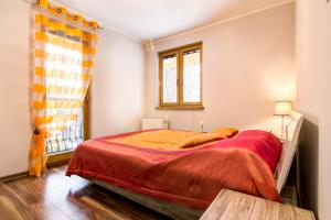 Łóżko lub łóżka w pokoju w obiekcie Apartament Brylantowy Zakopane