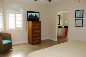 A television and/or entertainment center at Divi One Bedroom