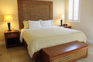 A bed or beds in a room at Divi One Bedroom