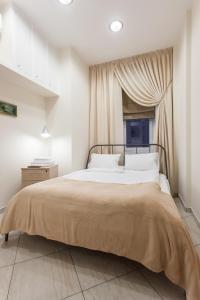 Кровать или кровати в номере Апартаменты «Дом со шпилем»