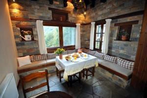 Εστιατόριο ή άλλο μέρος για φαγητό στο Παραδοσιακός Ξενώνας Αμάλθεια