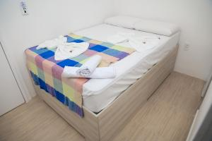 A bed or beds in a room at Pousada Meireles