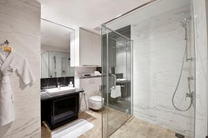 A bathroom at THE FACE Suites