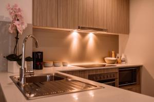 A kitchen or kitchenette at Quest Flemington
