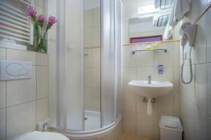 Een badkamer bij Hotel Kampa Garden