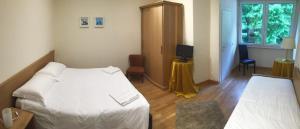 Letto o letti in una camera di Hotel Trieste