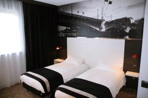 Un ou plusieurs lits dans un hébergement de l'établissement Hôtel des Lumières