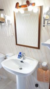 A bathroom at Astbury Apartments Ses Platgetes