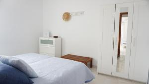 A bed or beds in a room at Astbury Apartments Ses Platgetes