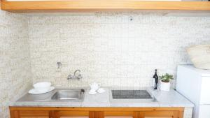 A kitchen or kitchenette at Astbury Apartments Ses Platgetes
