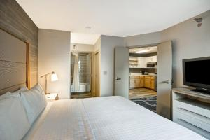 A bed or beds in a room at Homewood Suites by Hilton Chicago-Downtown