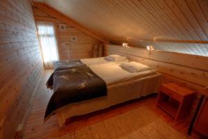 Vuode tai vuoteita majoituspaikassa Saija Lodge