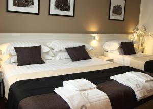 Letto o letti in una camera di Stelle Hotel The Businest