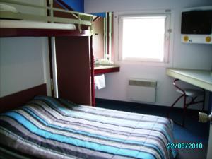 Кровать или кровати в номере hotelF1 Dieppe