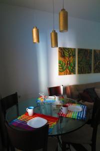 Um restaurante ou outro lugar para comer em Apartamento em Gramado